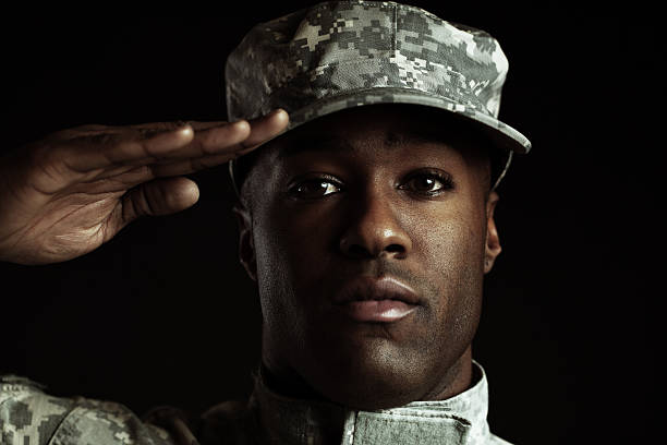 soldier at attention - saluting stock photos and pictures