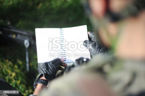 istock Soldier book 186940924