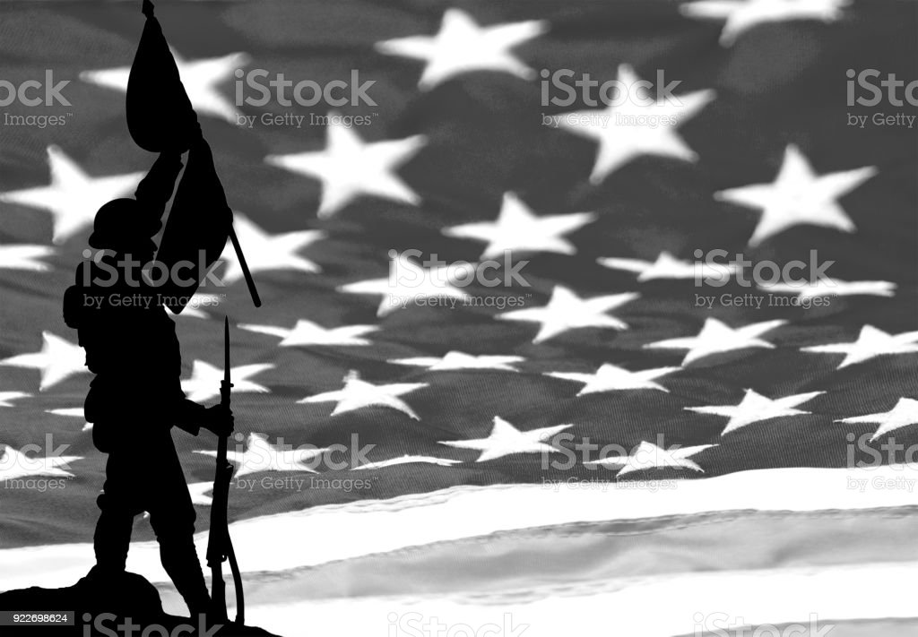 WW1 soldier carrying flag American flag background stock photo
