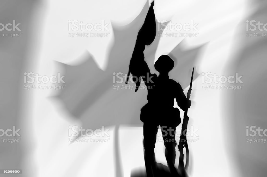 WW1 soldier carrying flag Canadian flag background stock photo