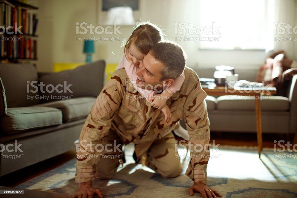 Soldier coming home stock photo