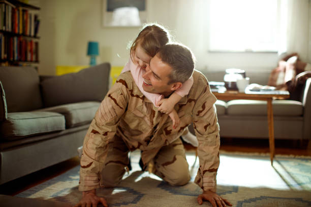 soldier coming home - armed forces stock photos and pictures