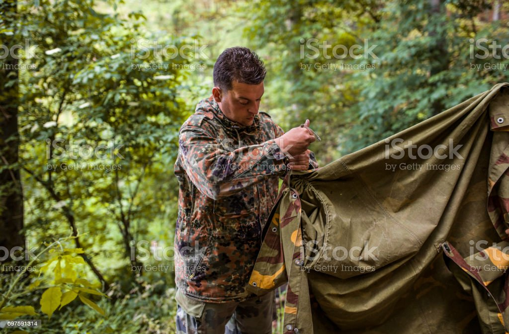 Soldier construct the tent stock photo