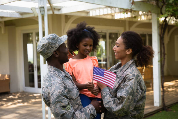 Soldier couple and daughter stock photo