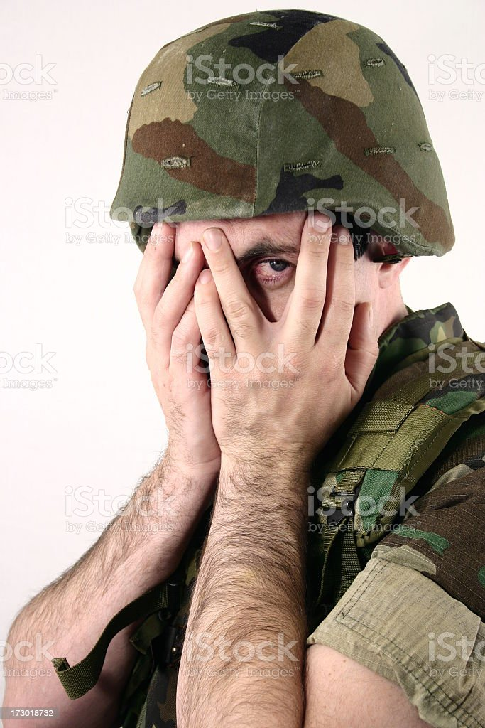 soldier covering his face royalty-free stock photo