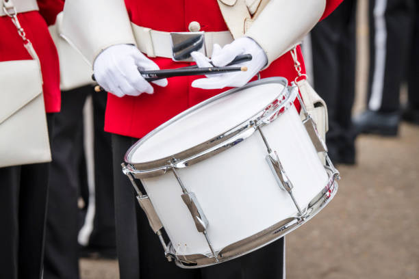 Soldier drummer in red uniform Soldier drummer in red uniform and white gloves playing drum in a march military parade stock pictures, royalty-free photos & images