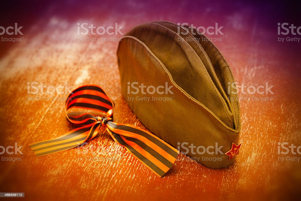 soldier field cap with a red star and George Ribbon royalty-free stock photo