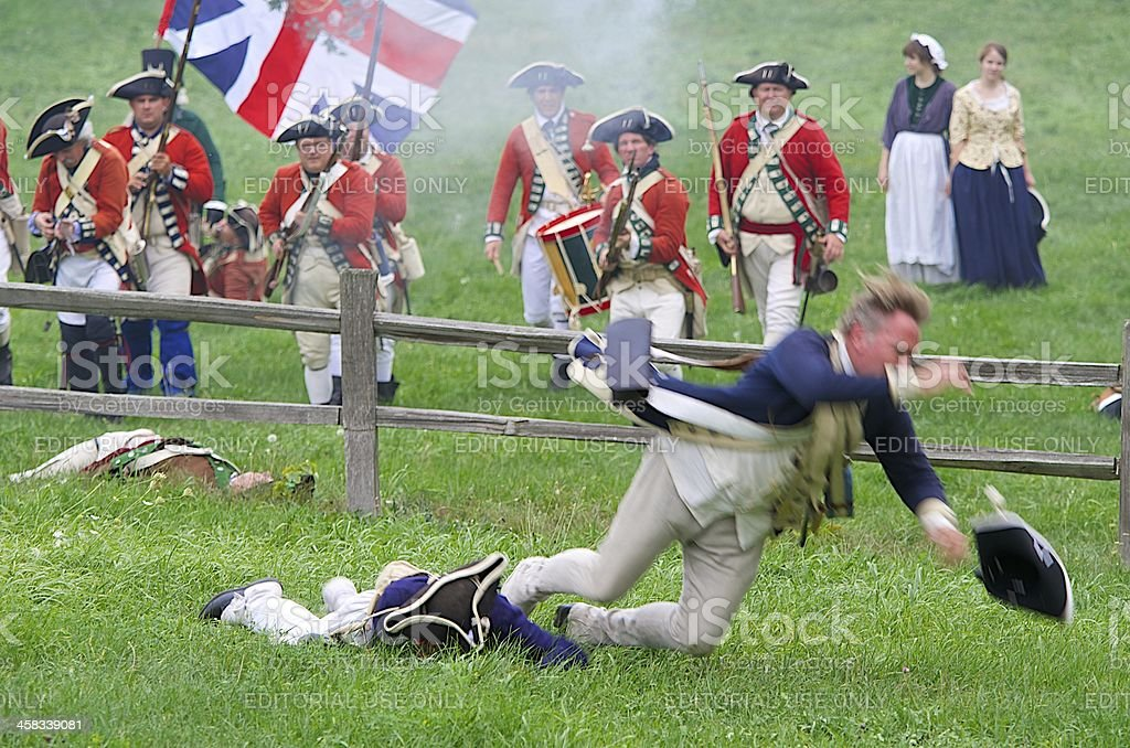Soldier Goes Down in a Revolutionary War Reenactment royalty-free stock photo