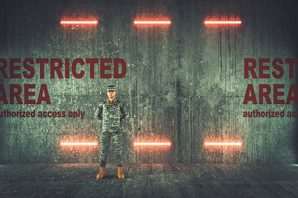 Soldier guarding restricted military area Soldier guarding restricted military area. bomb shelter stock pictures, royalty-free photos & images