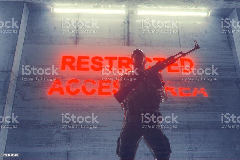 Soldier guarding secret underground facility stock photo