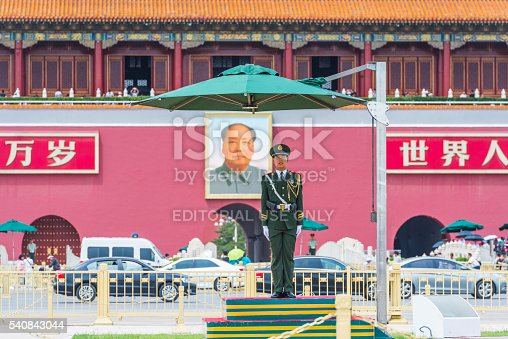 Beijing, Сhina - May 25, 2016: A soldier guards the Tiananmen Gate at Tiananmen Square.Tiananmen Square is China's famous landmark location