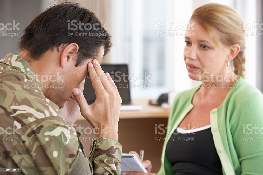 Soldier having a counseling session royalty-free stock photo