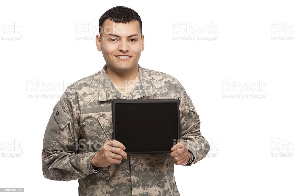 Soldier holding a computer tablet stock photo