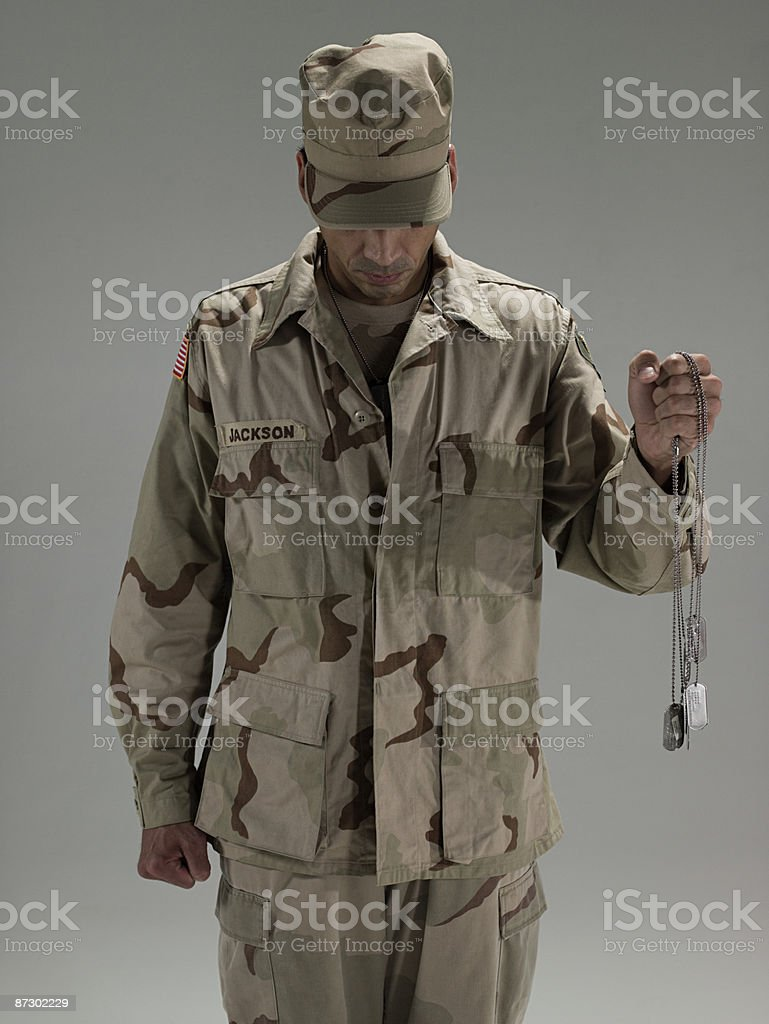 Soldier holding dog tags royalty-free stock photo