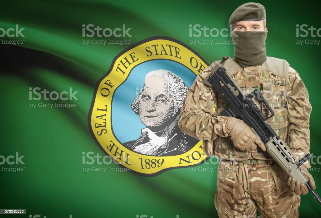 Soldier holding machine gun with USA state flag on background series - Washington stock photo
