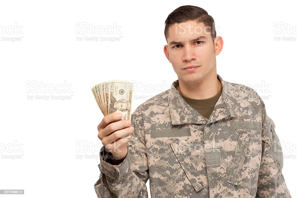 Soldier holding money stock photo