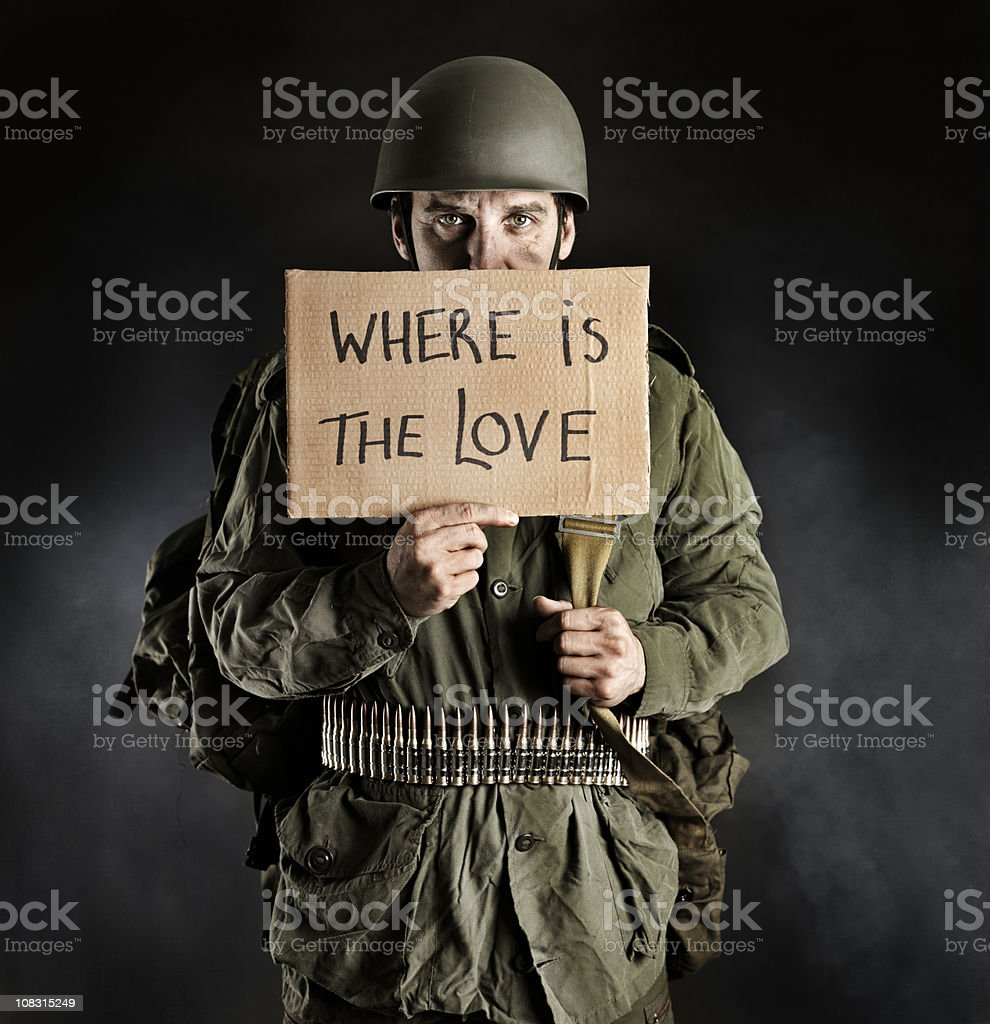 Soldier holding sign of Peace stock photo