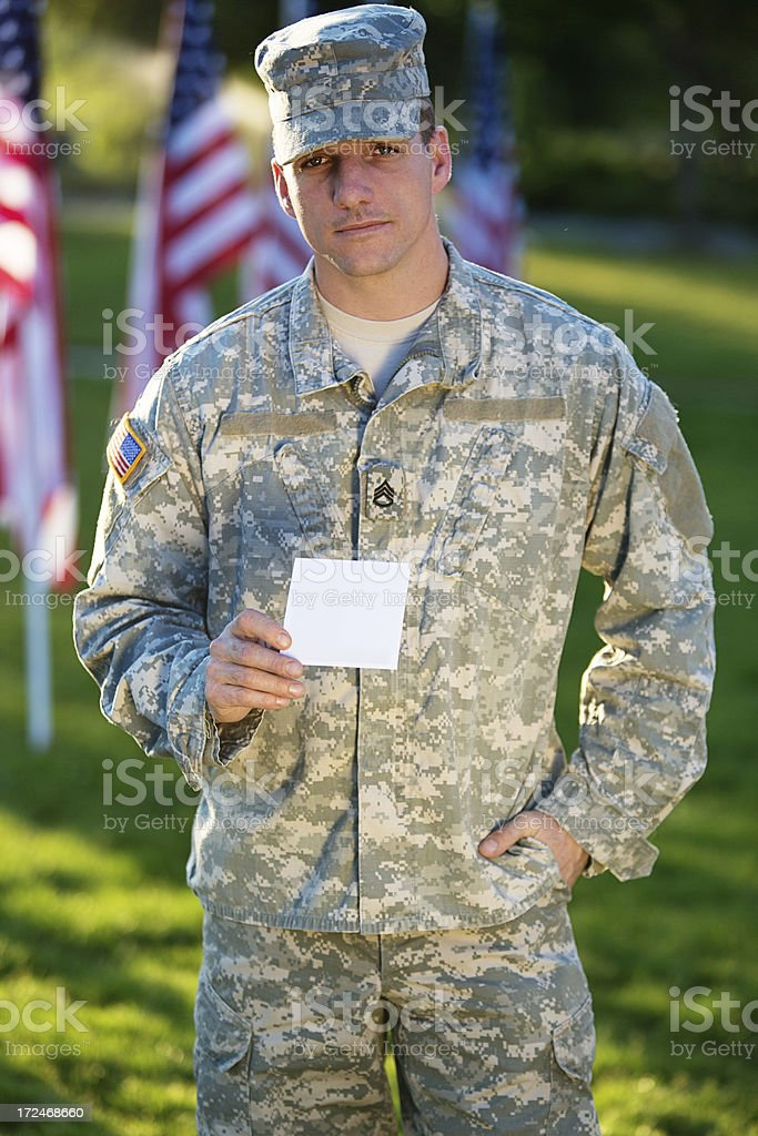 Soldier holding white card royalty-free stock photo