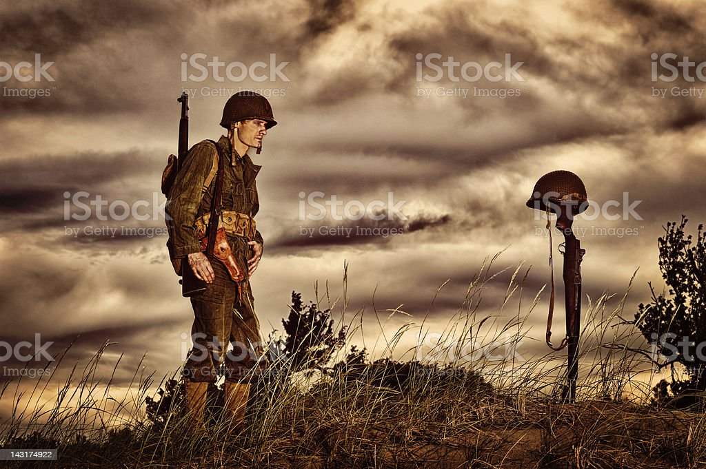 WWII Soldier Honoring Fallen Friend royalty-free stock photo