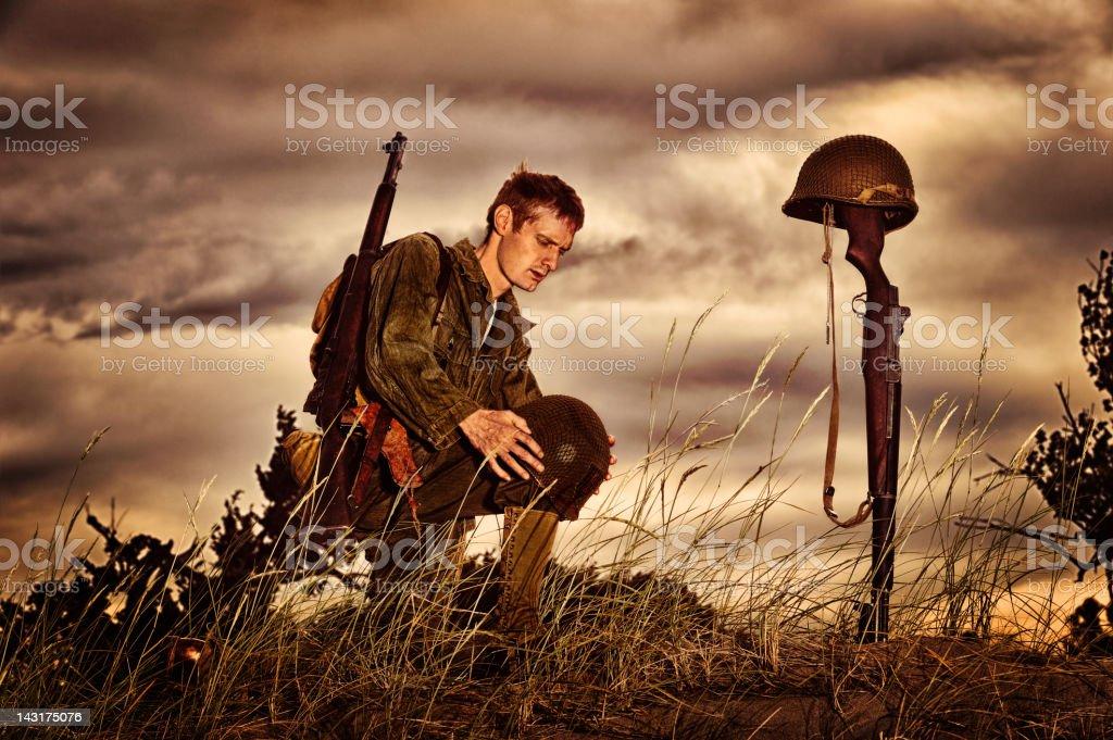 WWII Soldier Honoring Fallen Friend stock photo