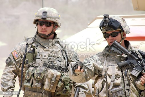 istock A soldier in a war zone giving orders 184951682