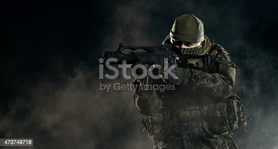 istock Soldier in an attack/defensive position. Going up in smoke. 473749718