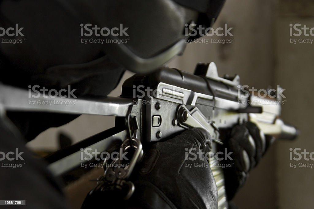 Soldier in bulletproof helmet targeting with AK-47 rifle stock photo