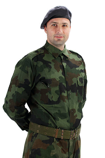 Soldier in fatigues uniforms. Soldier in fatigues uniforms. Isolated on white. beret stock pictures, royalty-free photos & images