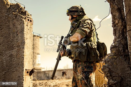 istock Soldier in the war with arms 943627524