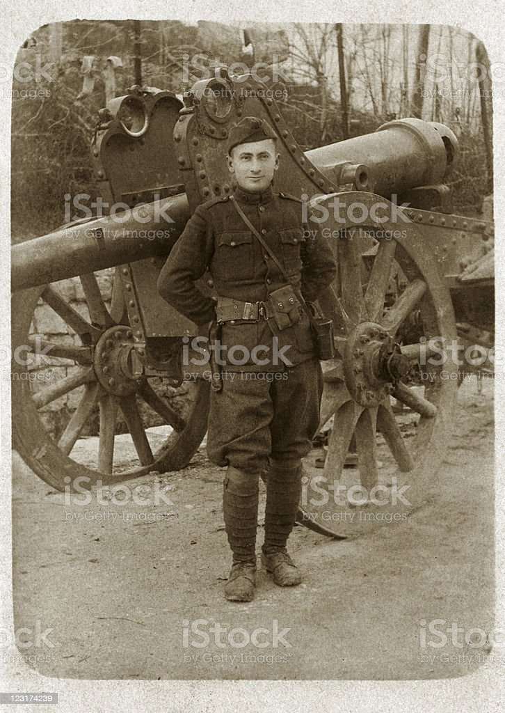 Soldier in Uniform with Cannon royalty-free stock photo