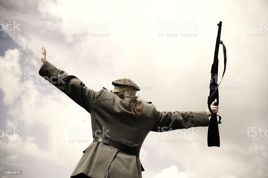 Soldier in victory pose stock photo