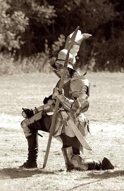 Soldier kneeling stock photo