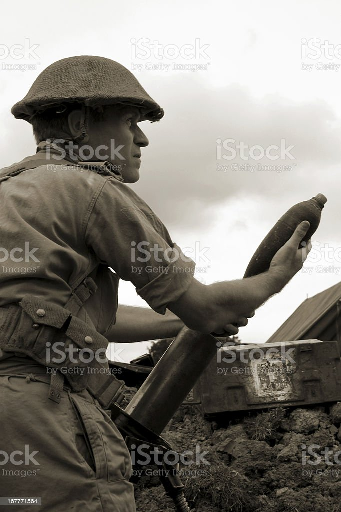 WW2 Soldier loading Mortar. stock photo