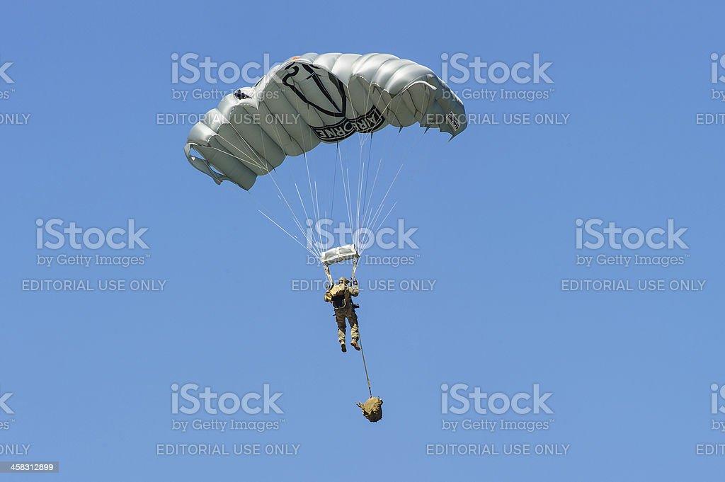 Soldier making parachute drop stock photo