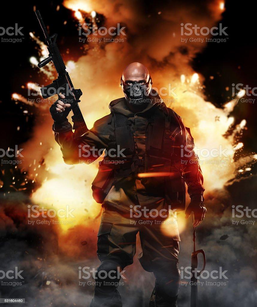 Soldier Man Hold Machine Gun on Explosion Background stock photo