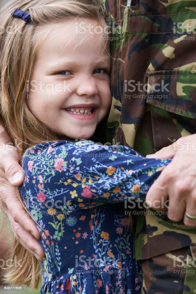 Soldier On Leave Being Hugged By Daughter stock photo