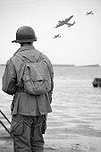 istock Soldier on  Omaha Beach. 157525530