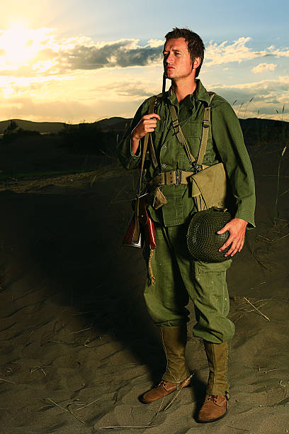 WW2 Soldier A World War 2 army soldier with sunset behind him. Authentic WW2 army uniform. More vintage military photos. early 20th century stock pictures, royalty-free photos & images