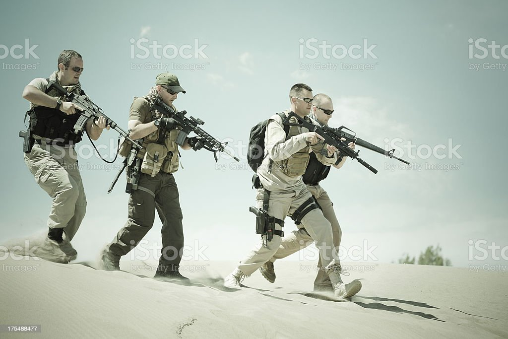 Soldier platoon training for combat in desert location stock photo