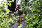 istock Soldier playing airsoft 1324021032