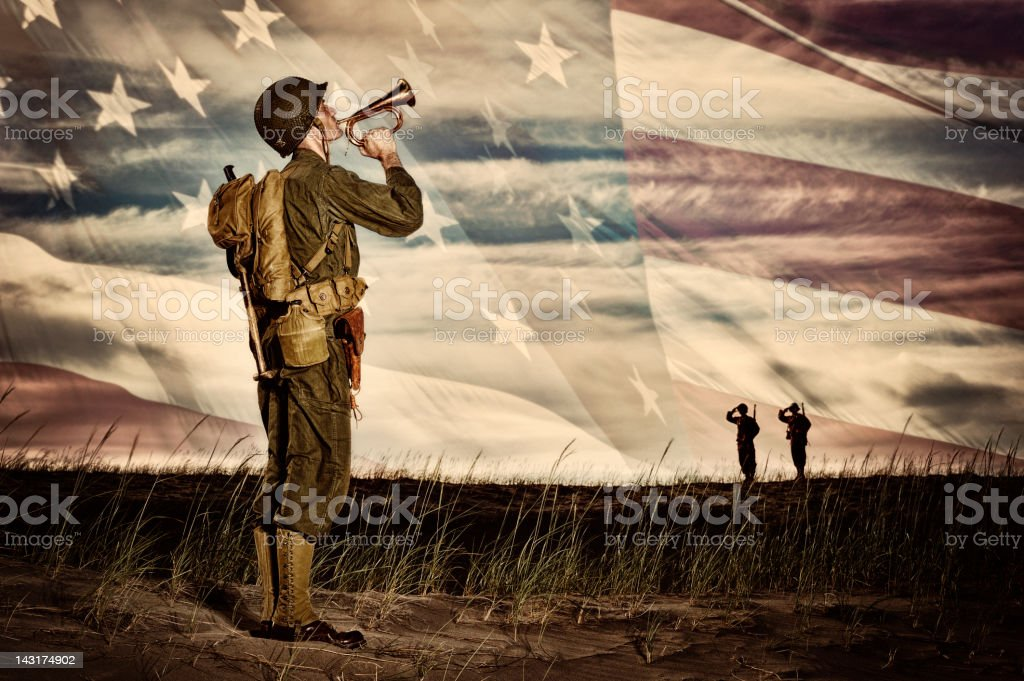 WWII Soldier Playing Taps With Flag Horizon stock photo