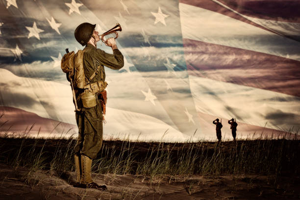 wwii soldier playing taps with flag horizon - world war ii stock photos and pictures