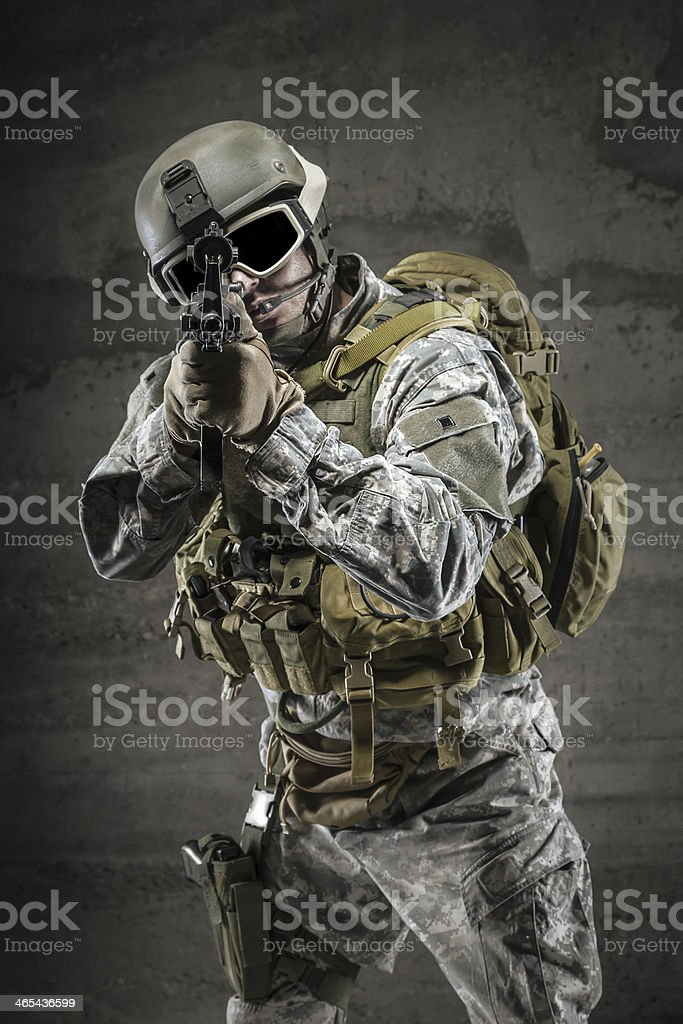 Soldier pointing gun at you stock photo