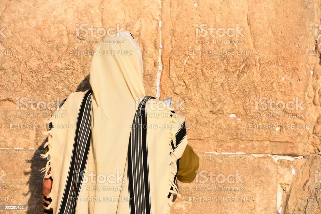 Soldier prays at the Western Wall stock photo