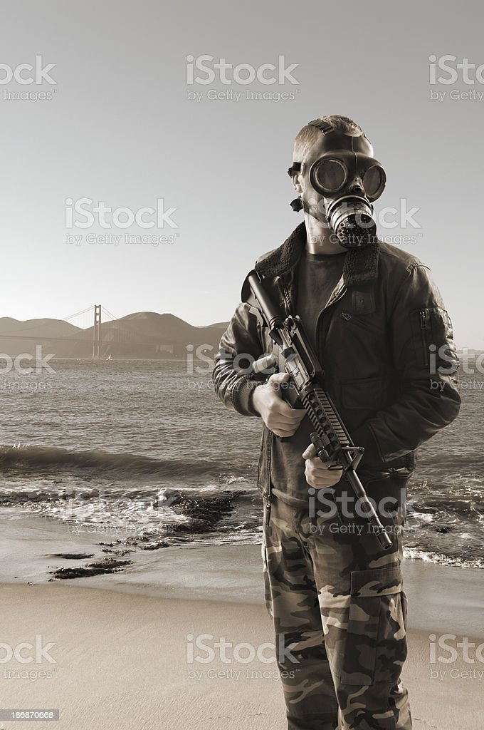Soldier Protecting a Polluted World stock photo
