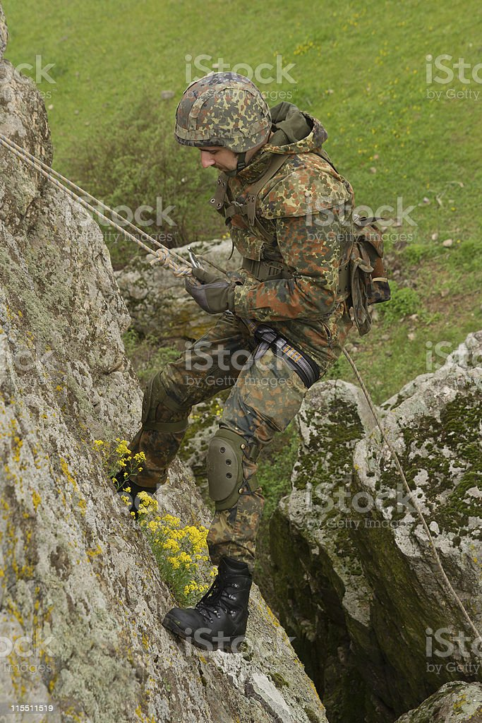 Soldier rappeling royalty-free stock photo