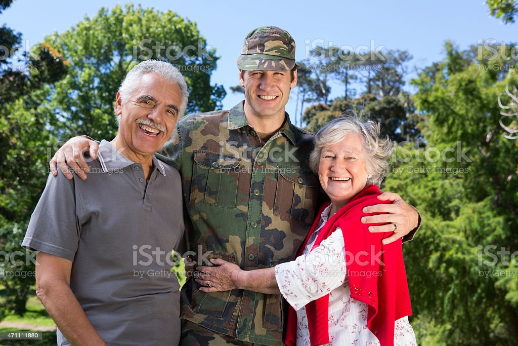 Soldier reunited with his parents stock photo