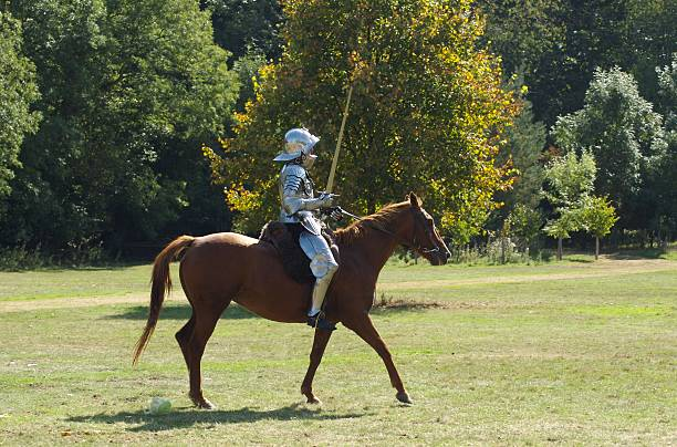 Soldier riding on horse stock photo