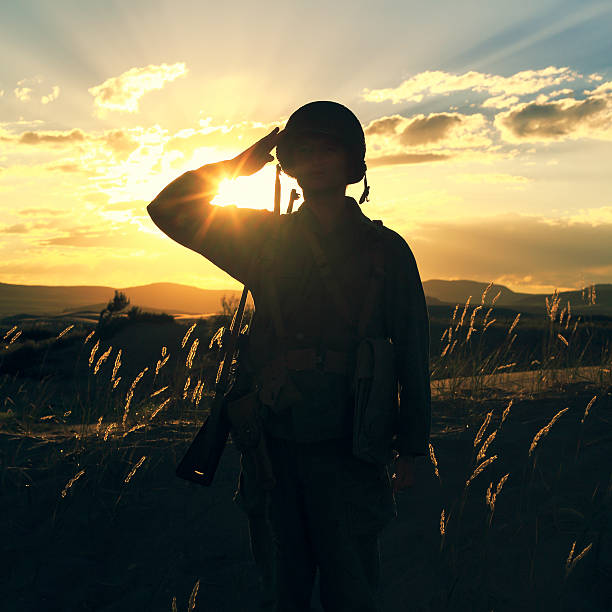 ww2 soldier salute - saluting stock photos and pictures
