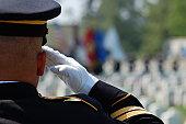 istock Soldier salutes fallen comrades 104206024